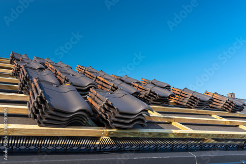 Obraz na płótnie Roof ceramic tile arranged in packets on the roof on roof battens