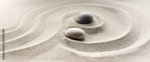 Staande foto Stenen in het Zand zen garden meditation stone background with stones and lines in sand for relaxation balance and harmony spirituality or spa wellness