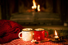 Christmas And New Year's Mugs With Cocoa By The Fireplace With A Warm Sweater And Cinnamon And Anise