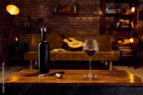 Glasses of red wine on table at home - 300442786