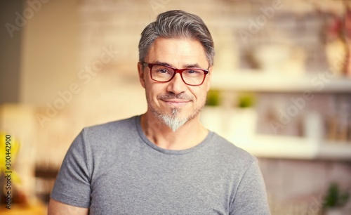 Portrait of happy older white man wearing glasses.
