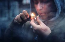Addicted Man Smokes Marijuana