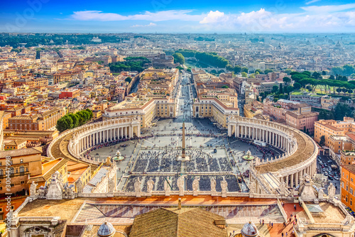 Famous Saint Peter's Square in Vatican and aerial view of the Rome city during sunny day Canvas Print
