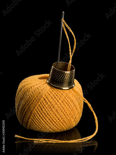 Hank of threads for darning, needle and brass thimble Canvas Print