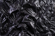 Top View Of Black Plastic Bag Texture And Background. Reduction Of Plastic Bags For Natural Treatment. Recycle And World Environment Day Concept.