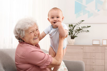 Happy Grandmother With Little ...