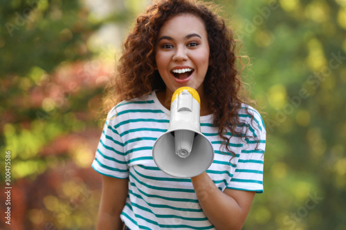 Happy African-American woman with megaphone outdoors Canvas Print
