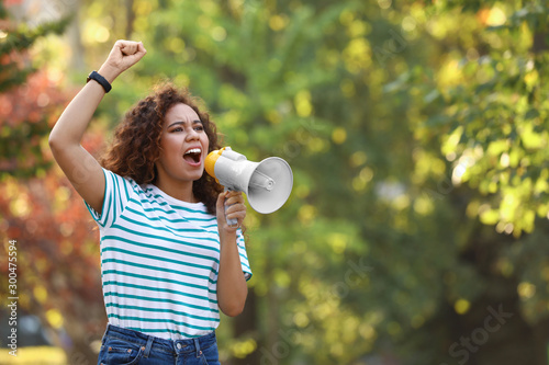 Angry African-American woman with megaphone outdoors Canvas Print
