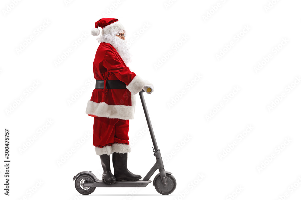 Fototapety, obrazy: Santa Claus riding an electric scooter