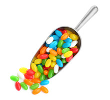 Scoop Of Tasty Jelly Beans On White Background, Top View