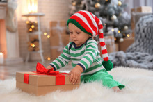 Little Baby With Elf Hat And C...