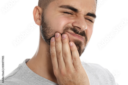 Man suffering from acute toothache on white background, closeup Wallpaper Mural