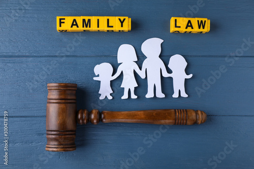 Obraz Flat lay composition with figure and gavel on blue wooden background. Family law concept - fototapety do salonu