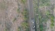 flying camera shoots like a train in the jungle of Vietnam, overlooking the city of Nha Trang, different angles, view from the top down