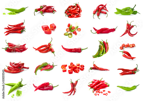 Poster Hot chili peppers Set with hot chili peppers isolated on white
