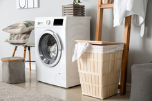 Interior Of Home Laundry Room With Modern Washing Machine