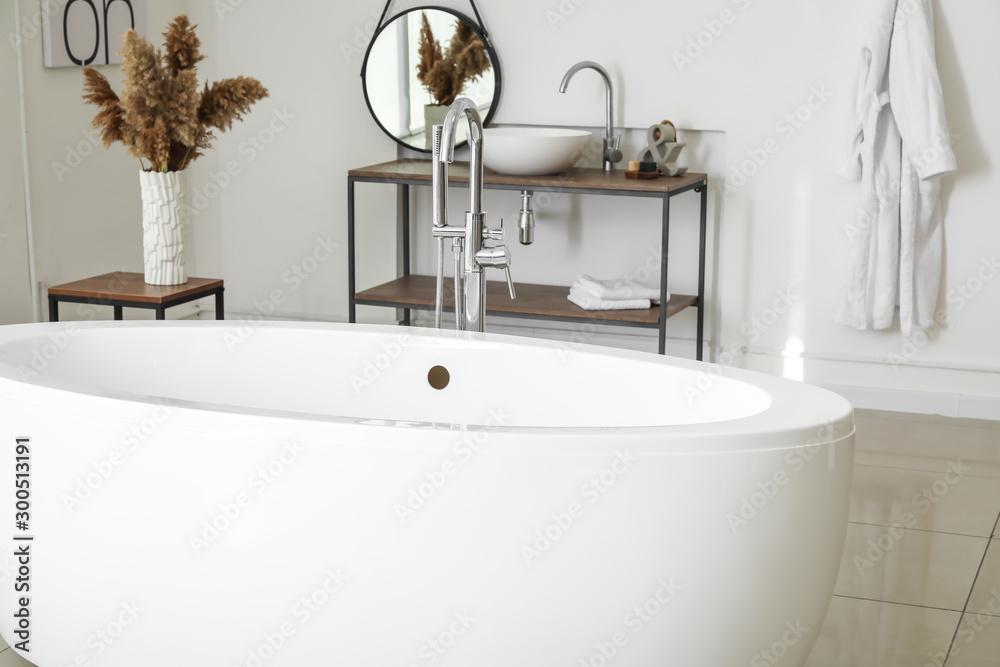 Fototapety, obrazy: Modern ceramic bathtub in light interior