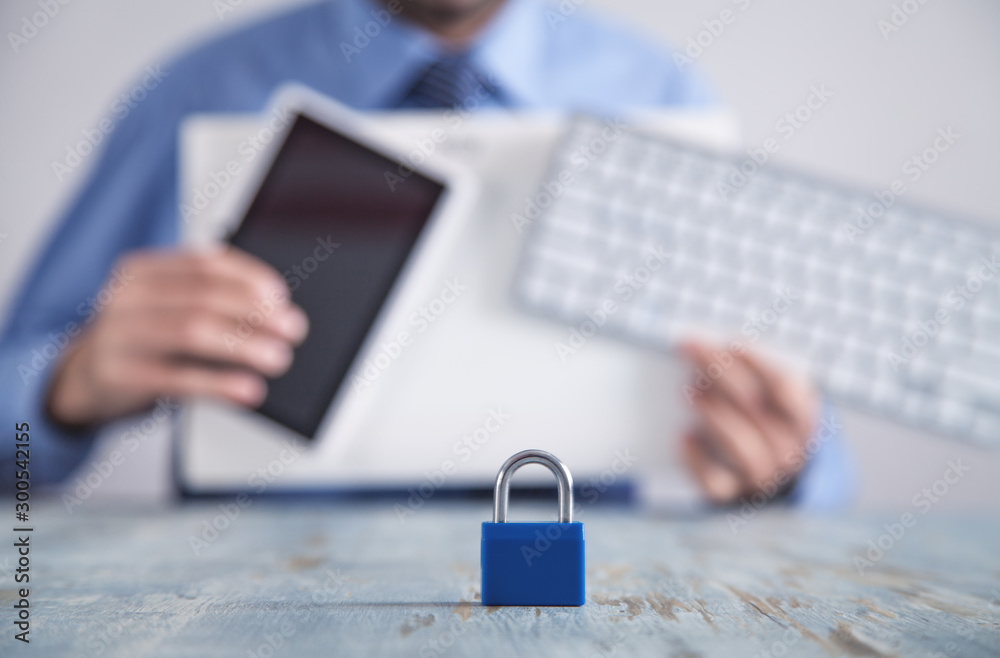 Fototapety, obrazy: Padlock on the desk. Man holding tablet and computer keyboard. Internet and computer security