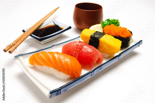Fotomural  Sushi salmon & tuna sushi shrimp and wasabi on the white plate isolated