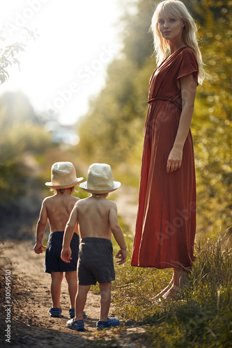 Staande foto Artist KB Young mother on the country walk with her sons