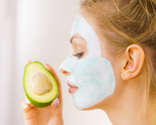 Girl Facial Mud Mask Holds Avo...