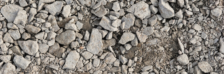 Panoramic image. Gray gravel stones for the underground in road construction