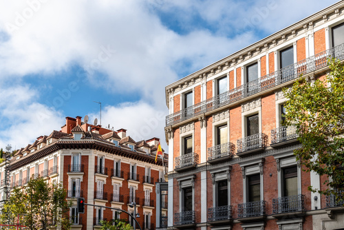 Obraz Old luxury residential buildings with balconies in Serrano Street in Salamanca district in Madrid - fototapety do salonu