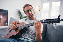 Man Playing Acoustic Guitar In...