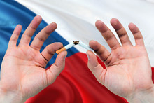 Czech Republic Quit Smoking Cigarettes Concept. Adult Man Hands Breaking Cigarette. National Health Theme And Country Flag Background.