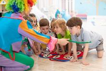Happy Children And Clown On Bi...