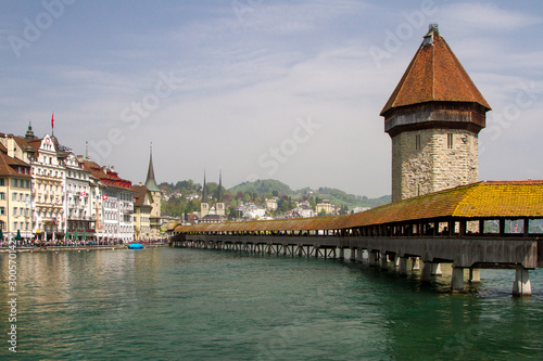 Leinwand Poster Famous Chapel bridge in Lucerne in a beautiful summer day, Switzerland