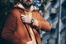 Street Style 2019 Fashion, Close Up Detail Of Men's Fashion Accessory. Man Checking The Time On His Leather Wrist Watch.