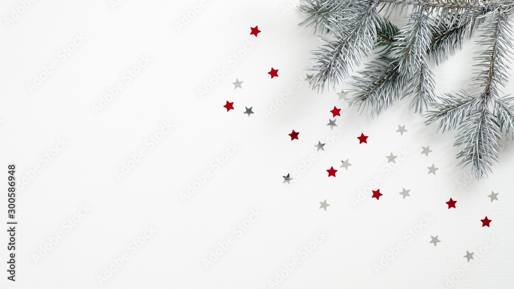 Fototapety, obrazy: Christmas tree branch and confetti stars on white background. Flat lay, top view, copy space. Xmas banner mockup, winter holidays frame, greeting card template