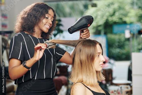 Positive Young Black Hairdresser
