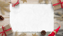 Blank Christmas Card Mockup For Greeting Text. Piece Of White Paper Surrounded With Gifts And Christmas Decorations.