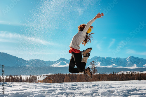 Happy girl jumps with snow winter concept Canvas Print