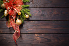 Golden And Red Christmas  Decorations On Dark Wooden Background