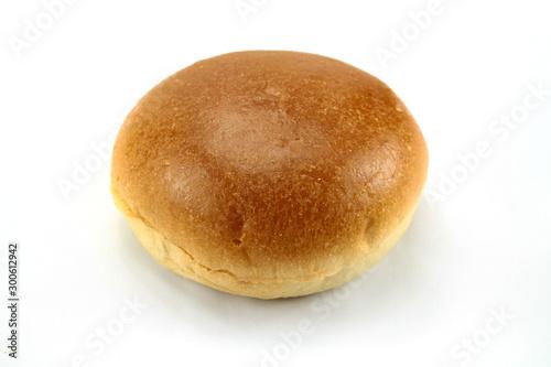 Fototapeta round bun on a white background obraz