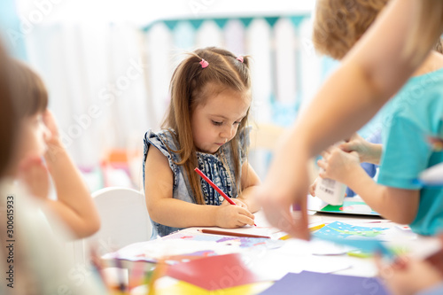 Preschool students in art class. Education, school, art and childhood concept