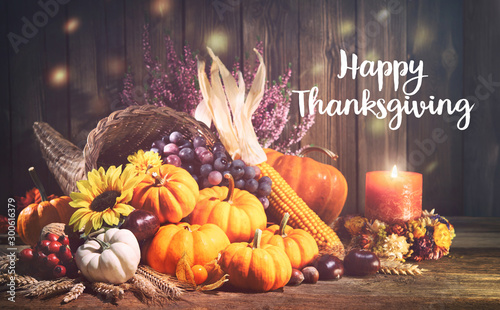 Fototapeta Pumpkins with fruits and falling leaves on rustic wooden table obraz