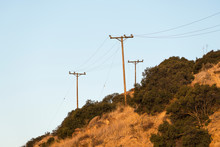 Old Rural Power Lines Above Dry Brush Hillside Near Los Angeles And Ventura County In Southern California.