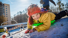 Funny Child Sled Down Icey Trek From Cellar In Winter Day. Little Boy With Emotional Face Riding Slide In The Playground