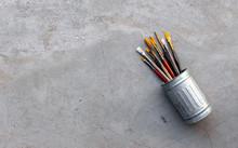 Closeup Of Paint Brushes In Di...
