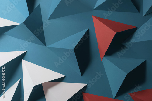 Composition with triangular shapes, red background