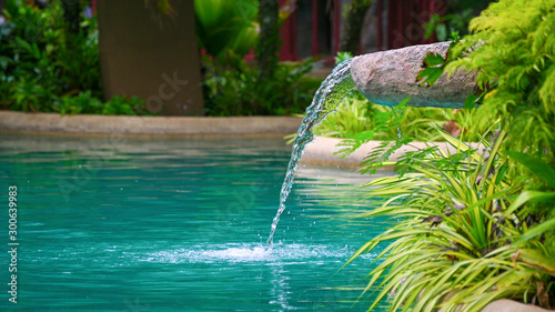 Recess Fitting Waterfalls Water flowing water falling into the pond, decoration of the edge of the poo