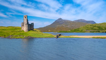 Mesmerizing Ruins Of Ardvreck Castle Standing On A Rocky Promontory Jutting Out Into Loch Assynt In Sutherland, Highlands Of Scotland.