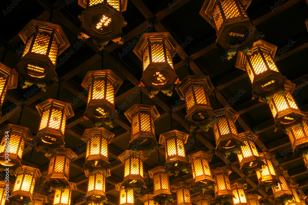 Fototapeta Thousands of lanterns hanging on the ceiling of Buddhist temple Shrine.
