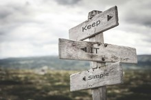 Keep It Simple Signpost. Nature, Adventure, Message, Text, Quote Concept.