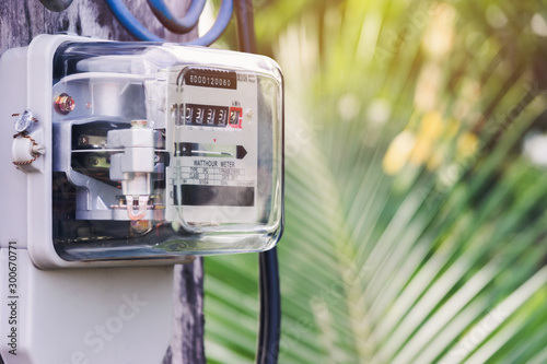 Electricity meter for house with sky background. Wallpaper Mural