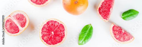 Fotografie, Obraz  Whole and sliced grapefruit isolated on white background